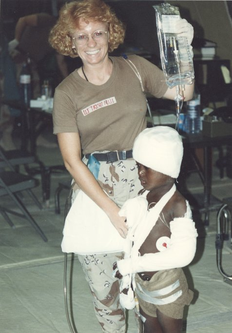 Lt. Patricia Hall with a wounded Somali boy