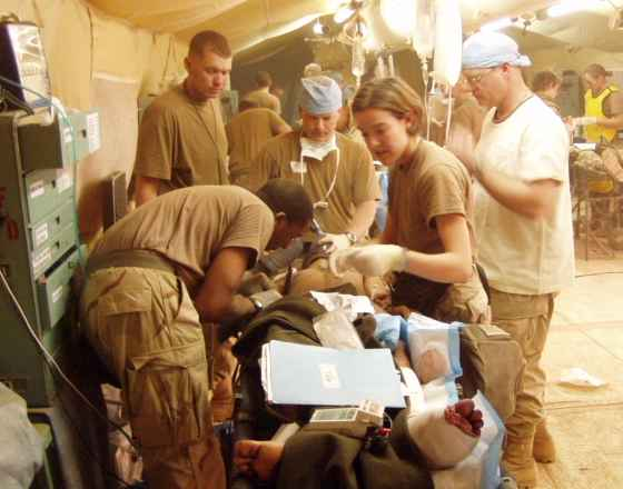 Triage in progress during an influx of casualties at the 212th Surg